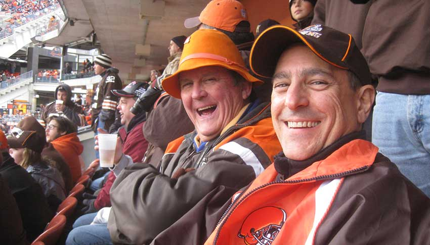 Big Brother Doug and Little Brother Mike, who were matched in the 1970s, take in a Cleveland Browns game in 2012.